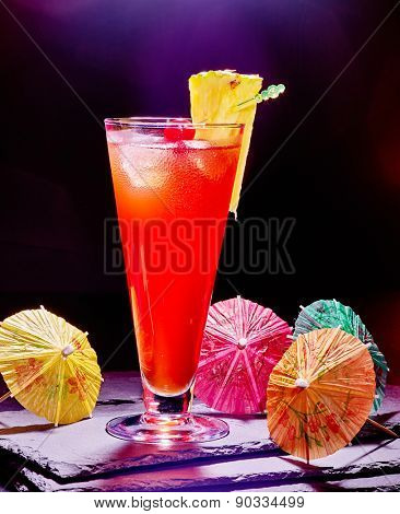 Pineapple cocktail skewer with cherry and umbrella  in highball glass . Cocktail card 41