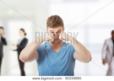 Handsome young depressed man crying.