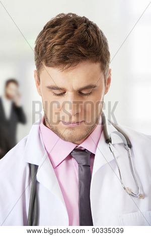 Young confident male doctor with stethoscope.