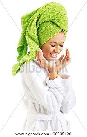 Laughing woman in bathrobe and towel on head.