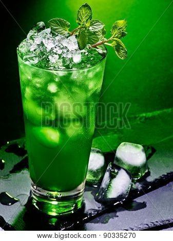 Green drink  with crushed ice and mint leaf on dark background 43