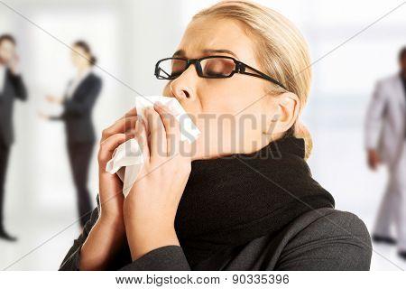 Beautiful woman sneezing because of flu.