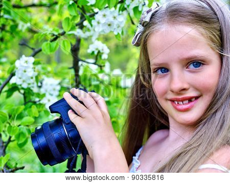 Girl take picture blossoming cherry tree. Romantic style.
