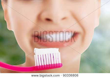 Woman with toothbrush and paste.