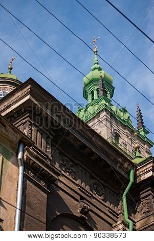 church with crosses on sky background and wires in the city