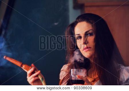 beautiful girl in smoke with hookah