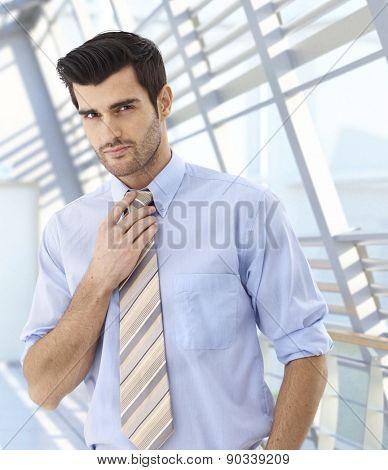 Portrait of caucasian businessman at modern business location.