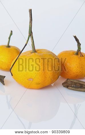 Ripe Orange With Dry Leaves Isolated On White