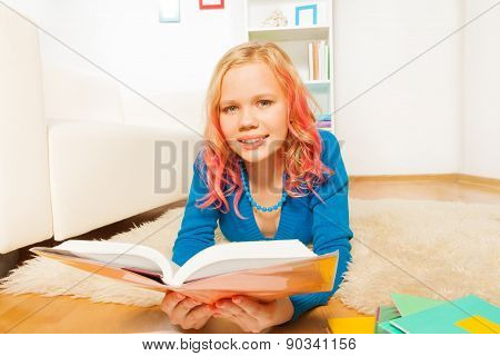 Blondie early teen girl read book at home