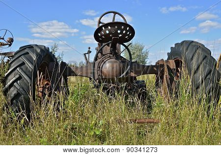 Old tractor parked in field