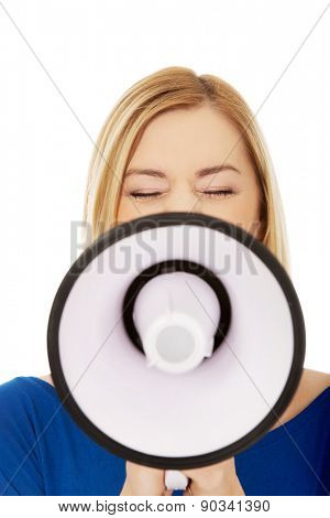 Young angry woman with megaphone.