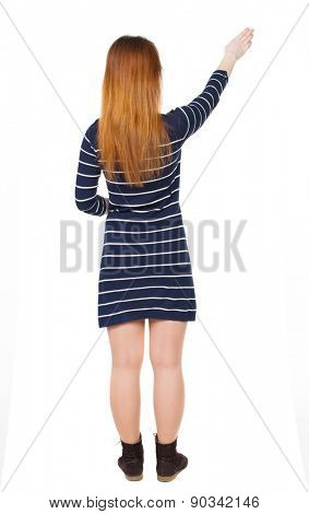 back view of woman. Young woman in vest presses down on something. Isolated over white background. Rear view people collection. backside view of person. The guide shows the exhibits.