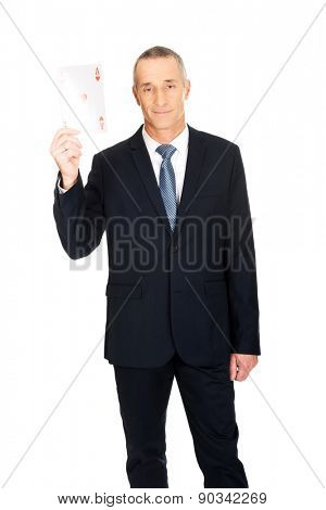 Elegant mature business man with red ace card.