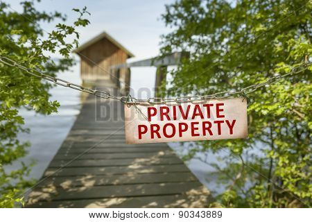 An image of an old private property sign