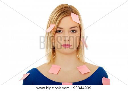 Young woman with sticky notes.