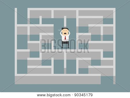 Frustrated businessman trapped in a maze