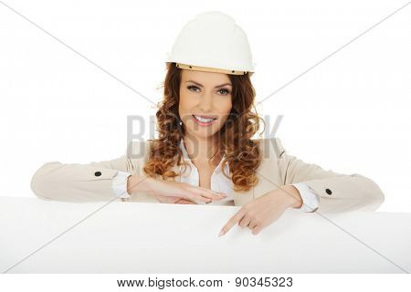 Architect business woman pointing on empty banner.