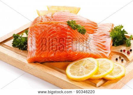 Fresh raw salmon steaks on cutting board