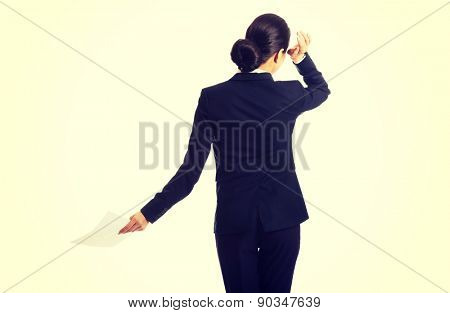 Back view of a businesswoman with paper notes.
