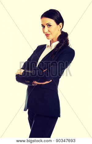 Confident businesswoman with folded arms.