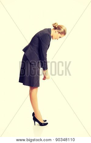 Businesswoman bending down and searching
