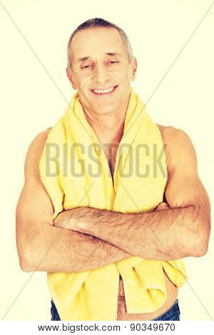 Smiling mature man with a towel around neck.