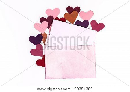 vintage envelope with paper hearts.