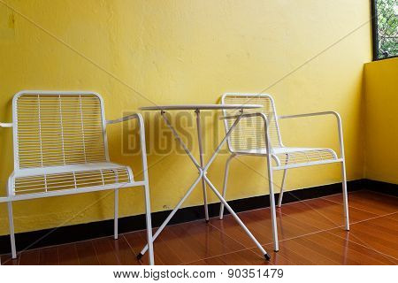 White Chair And Desk With Yellow Wall