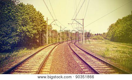 Retro Filtered Picture Of Railroad Tracks.