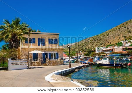 Small port with colorful boats, Greece