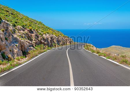 Curvy asphalt road leading to amazing sea bay
