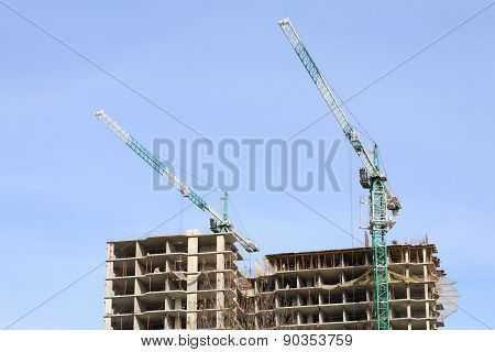 image of  house develop with crane at day