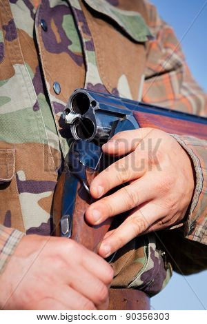 Hunter holding a rifle