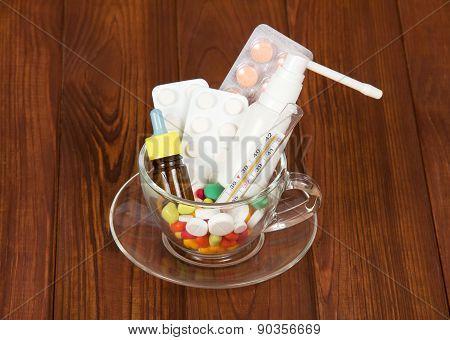 Cup with medicines