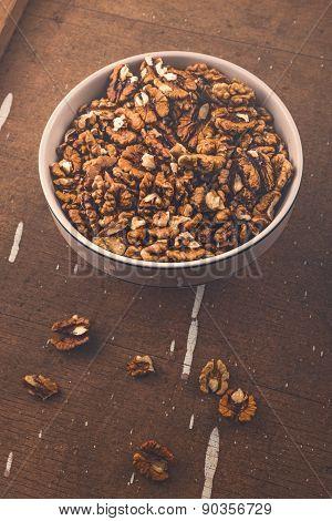 Walnut Kernels In Bowl On Brown Rustic Wood Plank Background