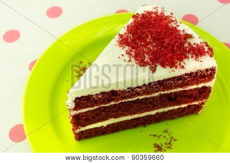 Red velvet cake on a green plate