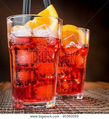 Spritz Aperitif Aperol Cocktail Glasses With Orange Slices And Ice Cubes