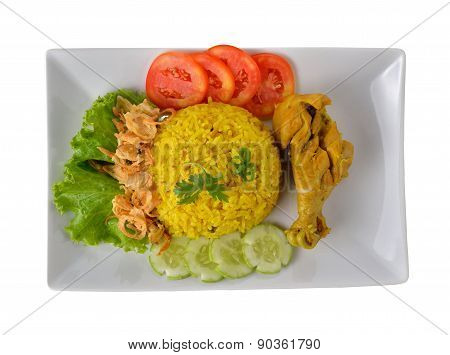 Chicken Biryani With Fragrant Yellow Rice On Plate