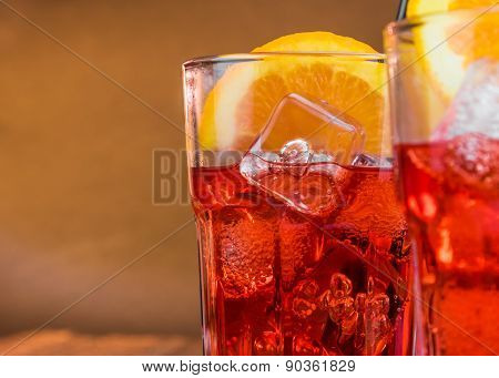Spritz Aperitif Aperol Cocktail With Two Orange Slices And Ice Cubes With Space For Text