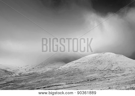 Beautiful Landscape Of Snow Covered Mountains During Late Afternoon In Winter In Monochrome Tones