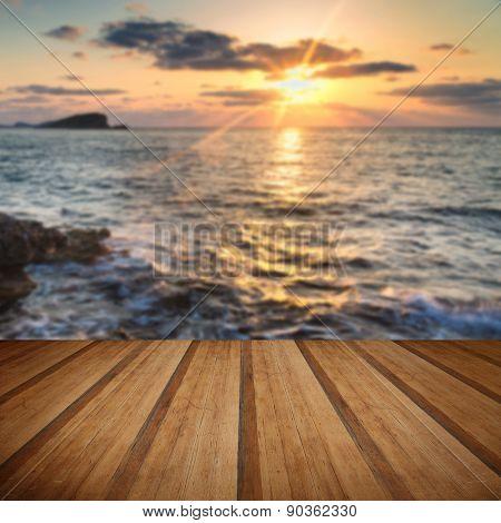Stunning Landscape dawn Sunrise With Rocky Coastline And Long Exposure Mediterranean Sea Wooden