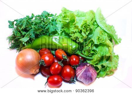 Vegetables And Greens For Salad On A White Background