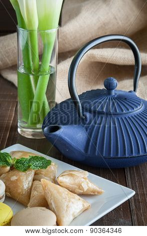 China Teapot With Flowers And Cakes