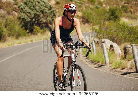 Young Woman Triathlon Athlete Cycling