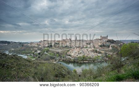 Wide angle view of Toledo with cloudy sky