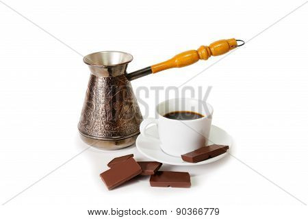 Coffee Pot, Cup Of Coffee And Chocolate  Isolated On White