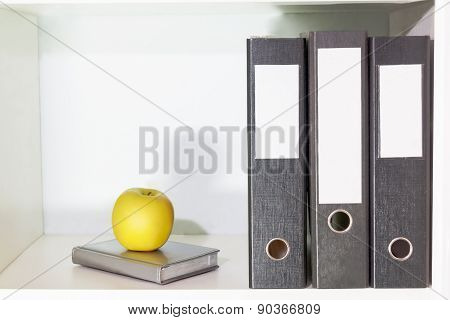 Folders For Documents, Planner And Green Apple On A Book Shelf