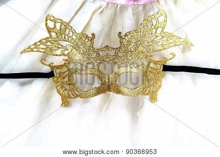 golden carnival mask on dress