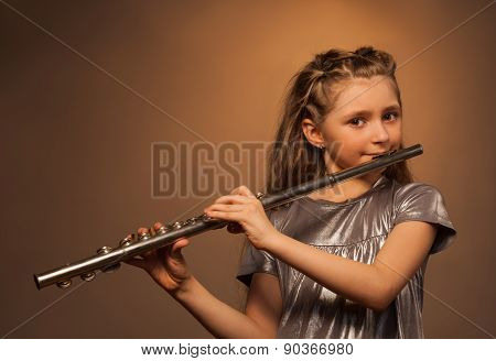 View of girl with long hair playing on flute