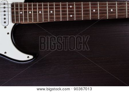 Electric guitar deck on dark background.